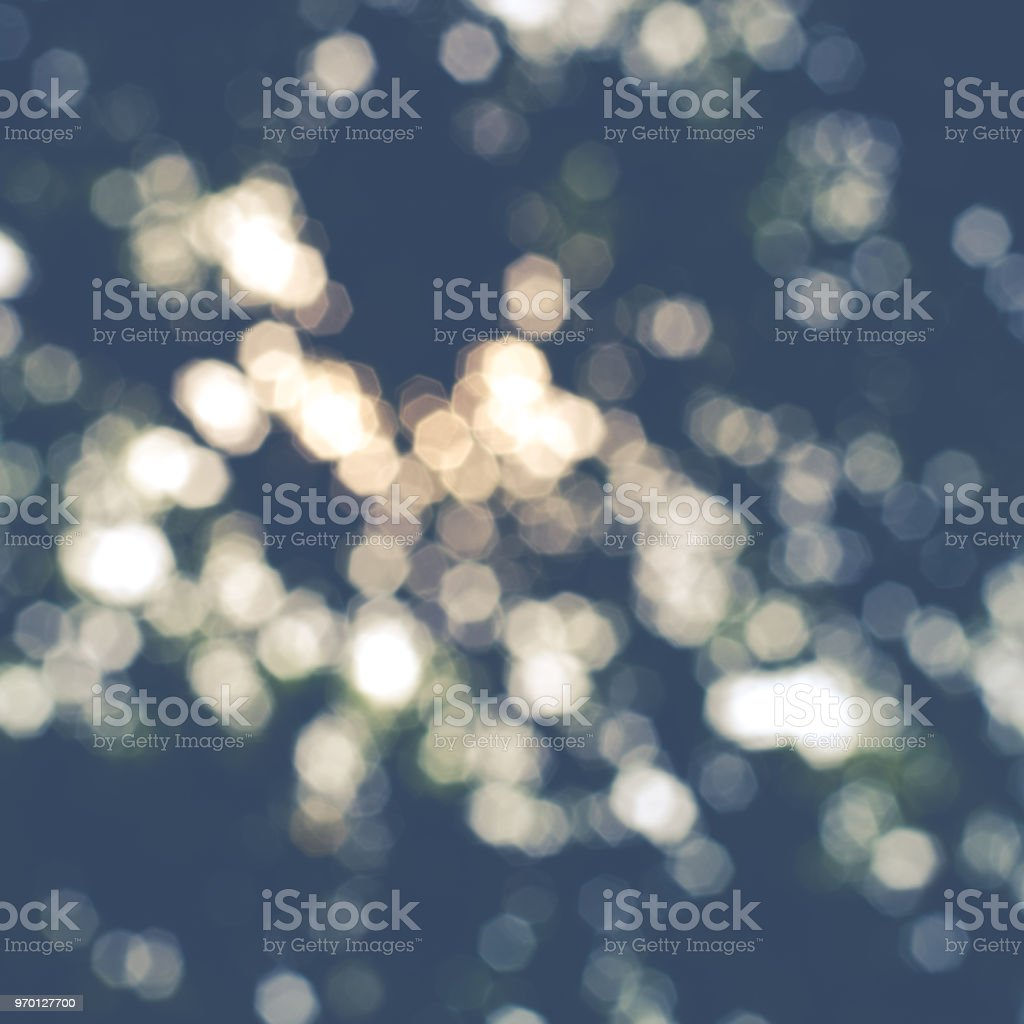 bokeh caused by sunlight shining through the trees, showing beautiful bokeh effect, good for using as background stock photo