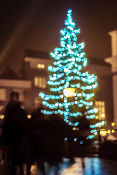Bokeh Christmas tree in city centre stock photo