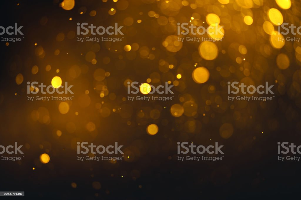 Bokeh circle abstract gold, black and white effect with flow and glitter star snow celebration for christmas night party light pattern background texture wallpaper. stock photo