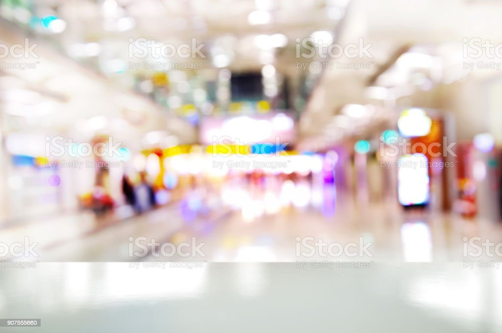 bokeh colorful bright white light indoor city background with display top of laminate stock photo