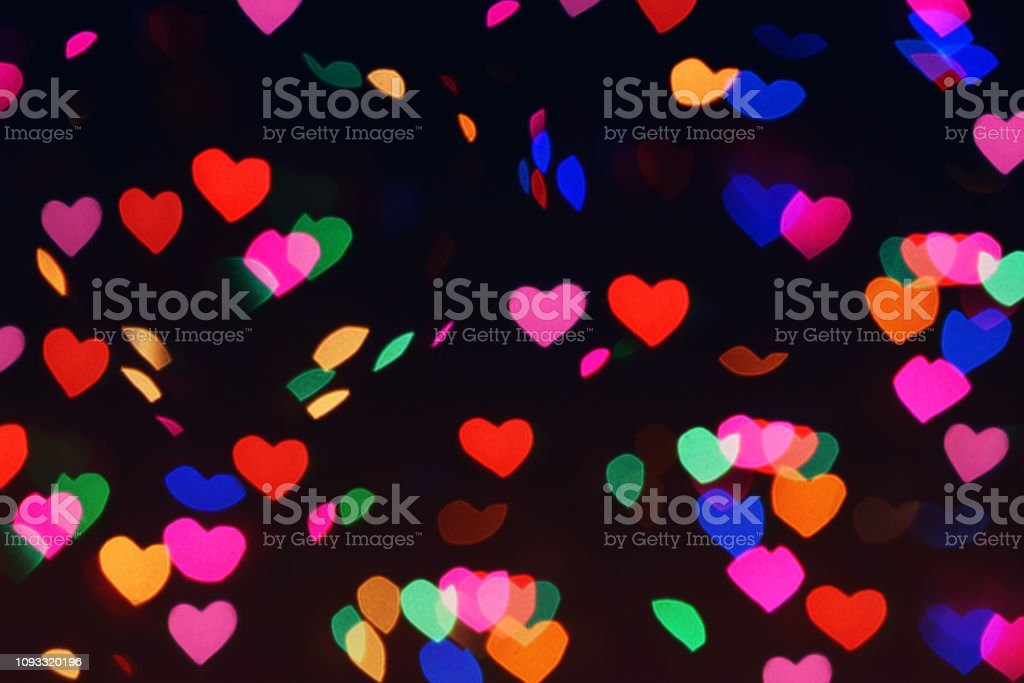 Bokeh hearts lights background. Bokeh romantic defocused night...
