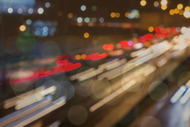 bokeh highway city traffic rush hour.  teleport to another dimension or timeline where moving cars are transported to another network. - timeline стоковые фото и изображения