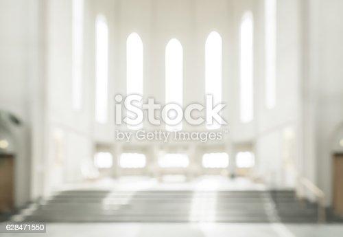 628471550 istock photo bokeh interior of modern  lutheran, christian church 628471550
