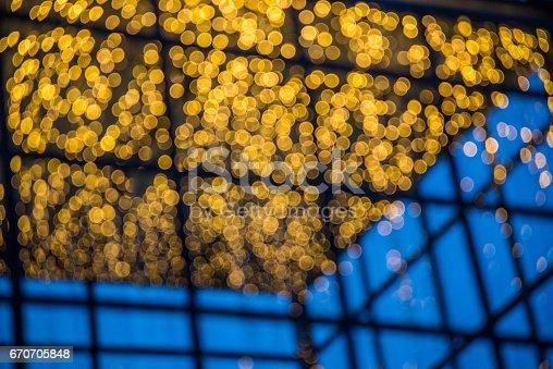 123458999 istock photo Bokeh light bulb at night background of Christmas light. 670705848