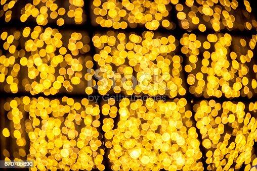 123458999 istock photo Bokeh light bulb at night background of Christmas light. 670705890