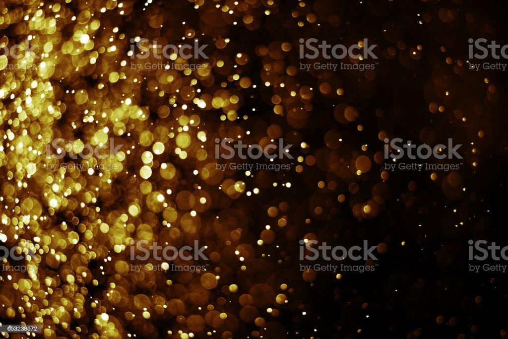 Bokeh light gold color black background ストックフォト