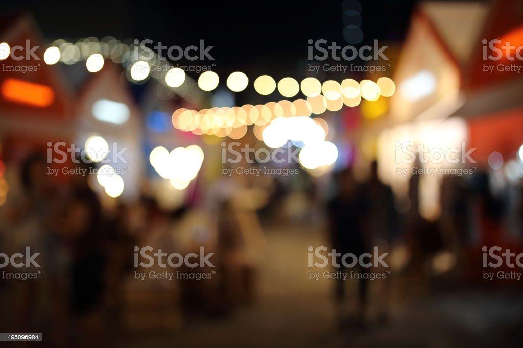 bokeh light in night market stock photo