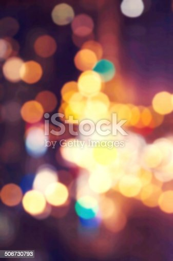 653331540 istock photo Bokeh light vintage background with night blurred lights. 506730793