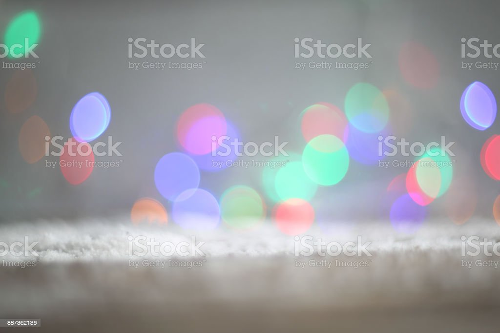 Bokeh lights over wooden background stock photo
