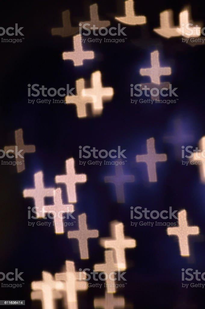 Bokeh lights shaped like crosses stock photo