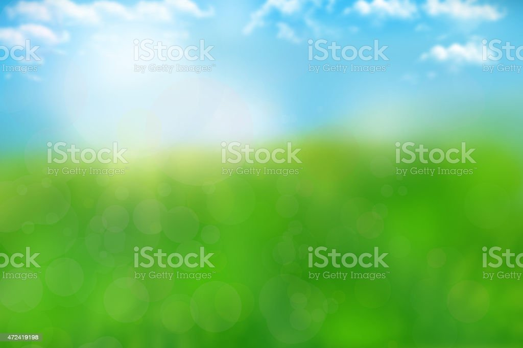 bokeh nature background with green grass and blue heaven stock photo