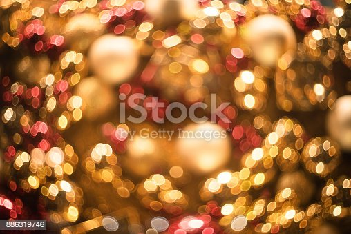 istock Bokeh. New Year bokeh background. Abstract background with colorful bokeh. Defocused lights. Background for Christmas cards. Beautiful blurred christmas balls. Christmas Lights. Christmas decorations 886319746