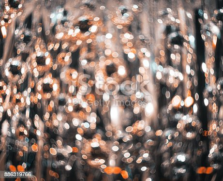 istock Bokeh. New Year bokeh background. Abstract background with colorful bokeh. Defocused lights. Background for Christmas cards. Beautiful blurred christmas balls. Christmas Lights. Christmas decorations 886319766