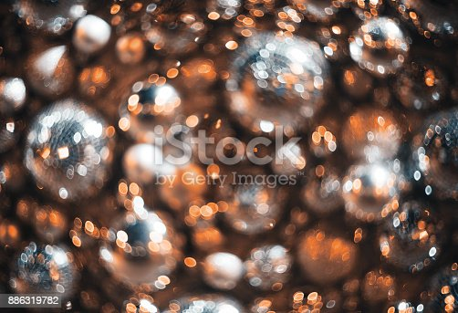 istock Bokeh. New Year bokeh background. Abstract background with colorful bokeh. Defocused lights. Background for Christmas cards. Beautiful blurred christmas balls. Christmas Lights. Christmas decorations 886319782