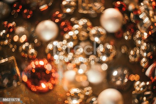 istock Bokeh. New Year gold bokeh background. Abstract background with colorful bokeh. Defocused. Background for Christmas cards. Beautiful blurred christmas balls. Christmas Lights. Christmas decorations 886319778