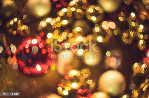 istock Bokeh. New Year gold bokeh background. Abstract background with colorful bokeh. Defocused. Background for Christmas cards. Beautiful blurred christmas balls. Christmas Lights. Christmas decorations 891131132