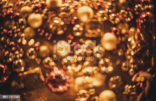 istock Bokeh. New Year gold bokeh background. Abstract background with colorful bokeh. Defocused. Background for Christmas cards. Beautiful blurred christmas balls. Christmas Lights. Christmas decorations 891131140