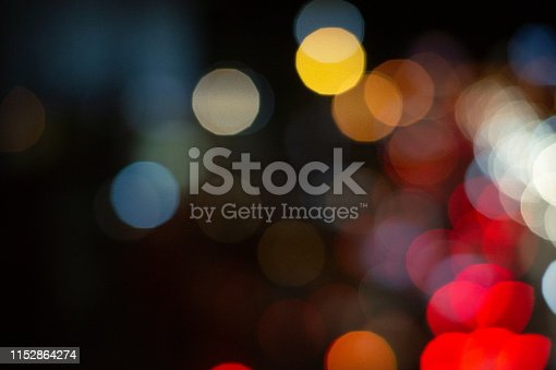 istock Bokeh night light on the avenue Light night at city blue bokeh sky festival abstract background blur lens flare reflection beautiful circle street with dark 1152864274
