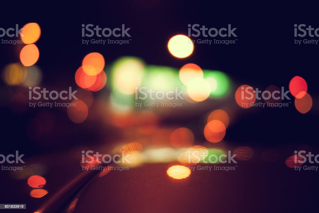 Bokeh on the street style vintage tone with colorful lights at night for background use. stock photo