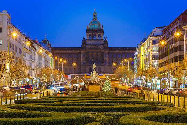 Bokeh photo of Wenceslas Square at night, Prague, Czech Republic The upper part of Wenceslas Square at night, New Town of Prague, Czech Republic wenceslas square stock pictures, royalty-free photos & images