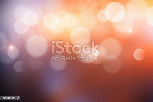 istock Bokeh sunlight with abstract blur orange lights. Sunset background. 859849428