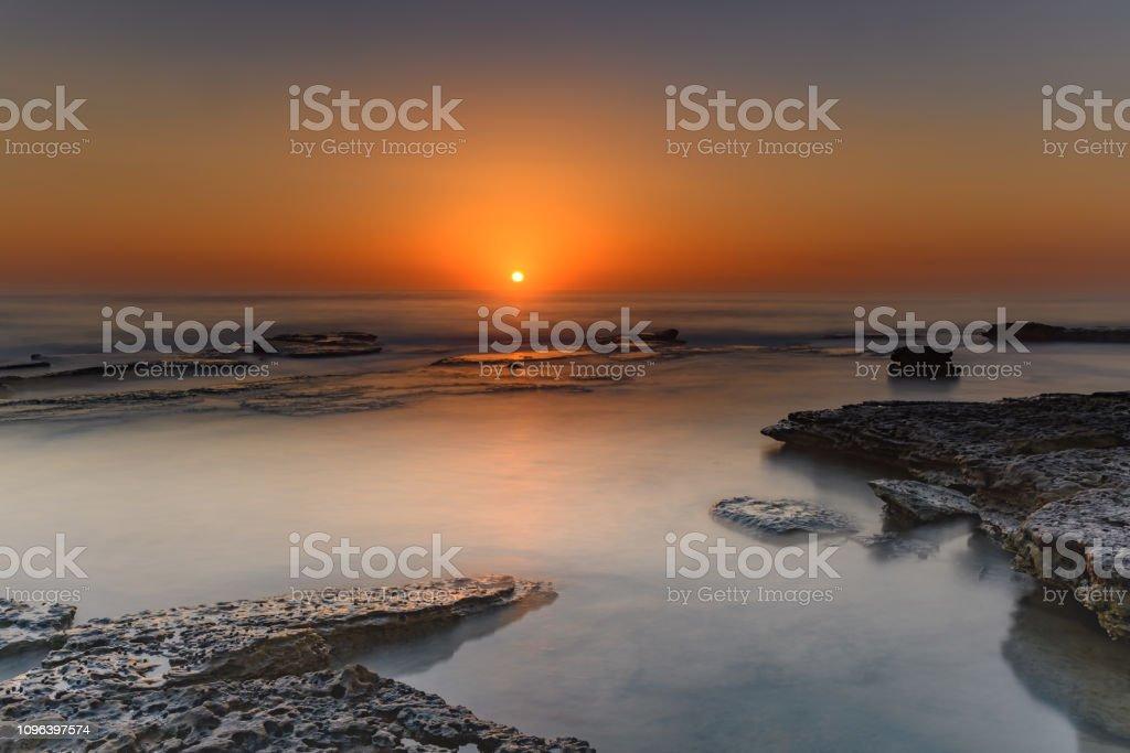 Bold Orange Sunrise Seascape stock photo