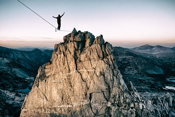 bold Slackline high in the mountains balance stock pictures, royalty-free photos & images