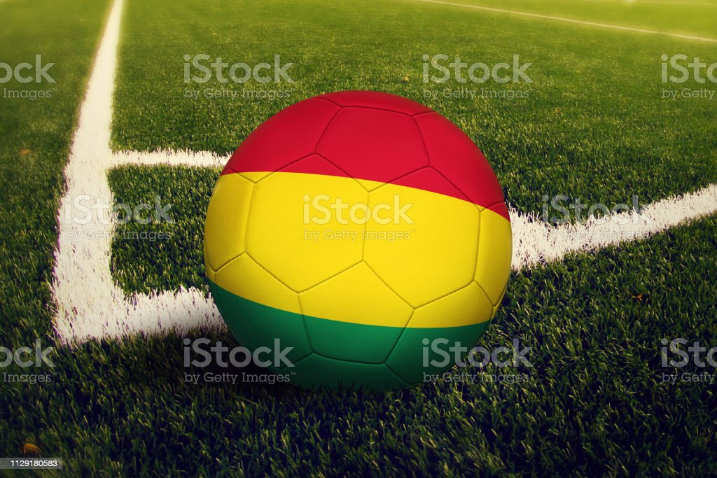 Bolivia ball on corner kick position, soccer field background. National football theme on green grass. stock photo