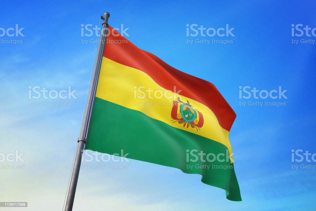 Bolivia flag waving in the blue sky stock photo