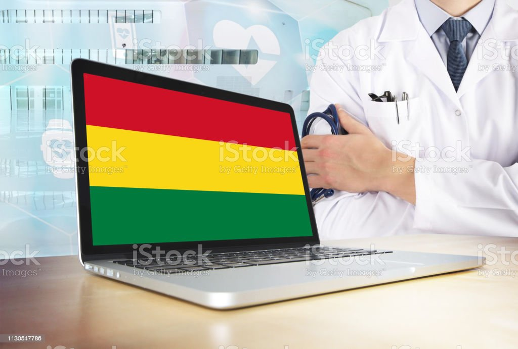 Bolivia healthcare system in tech theme. Bolivian flag on computer screen. Doctor standing with stethoscope in hospital. Cryptocurrency and Blockchain concept. stock photo