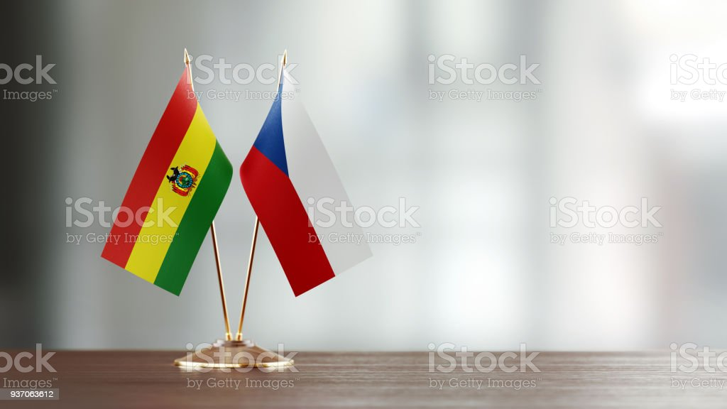 Bolivian And Czechoslovakian Flag Pair On A Desk Over Defocused Background stock photo