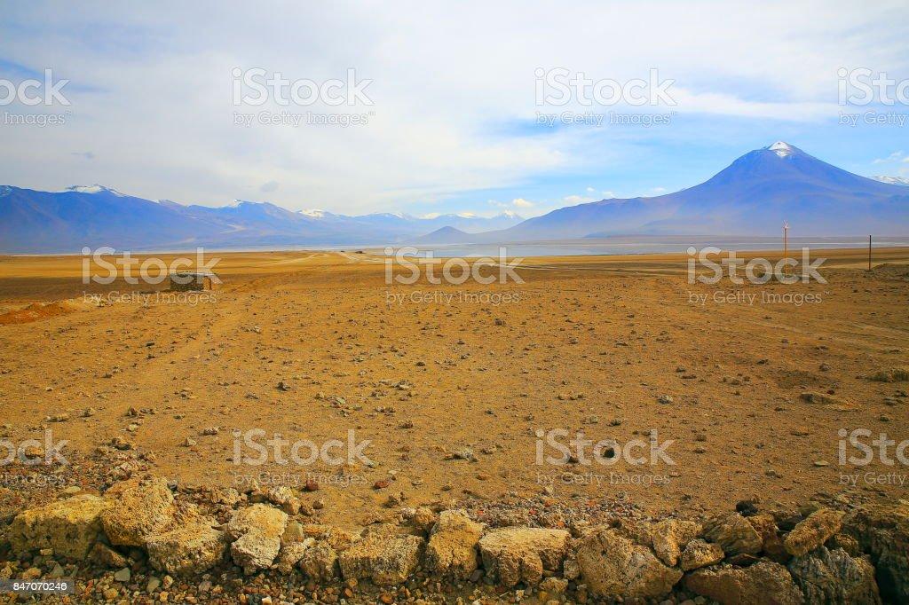 Bolivian Andes altiplano at sunrise and volcanoes near Uyuni, Idyllic Atacama Desert, snowcapped Volcanic steppe puna landscape panorama – Potosi region, Bolivian Andes, Chile, Bolívia and Argentina border stock photo