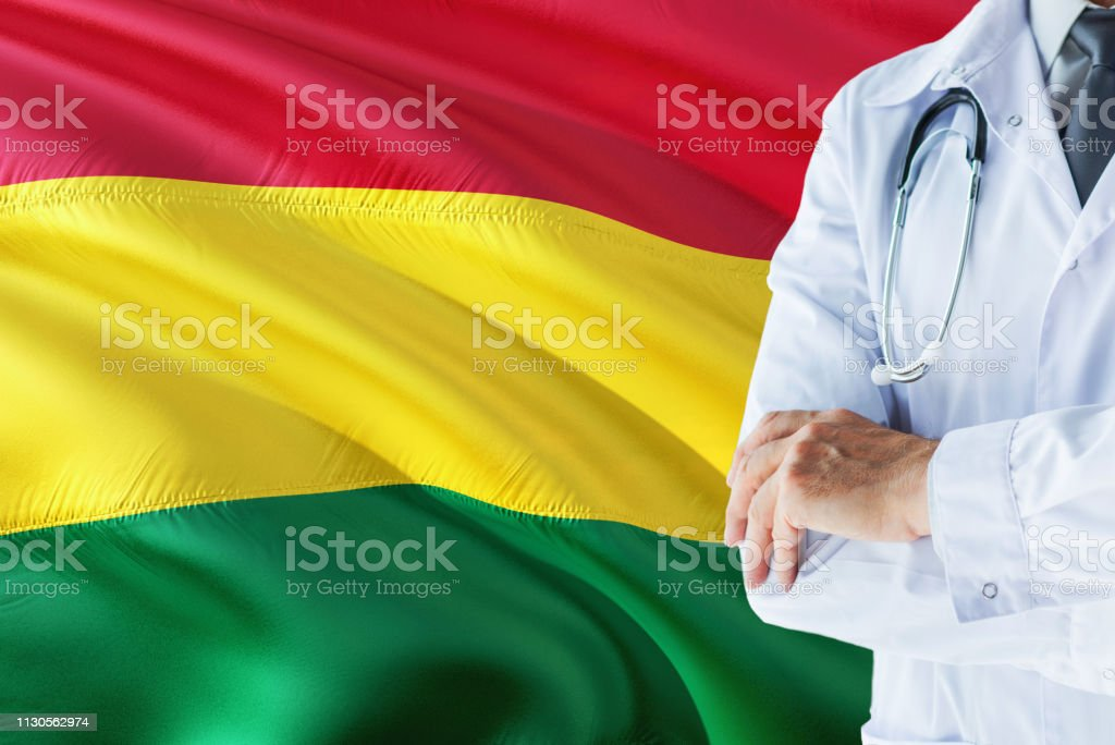 Bolivian Doctor standing with stethoscope on Bolivia flag background. National healthcare system concept, medical theme. stock photo