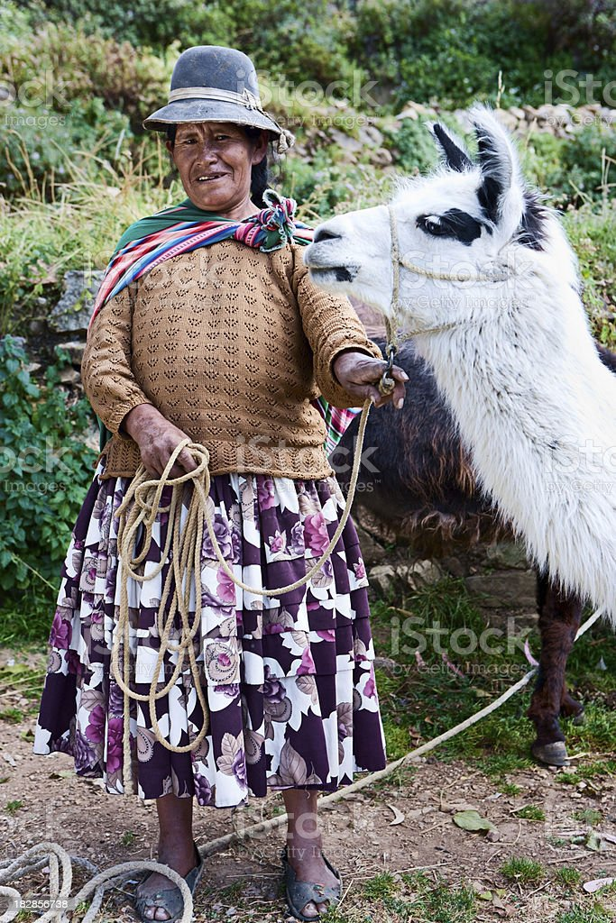 Bolivian woman in national clothing, Isla del Sol, Bolivia stock photo