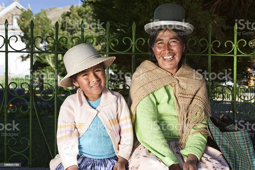 Bolivian woman with her daughter in national clothing, Copacabana stock photo