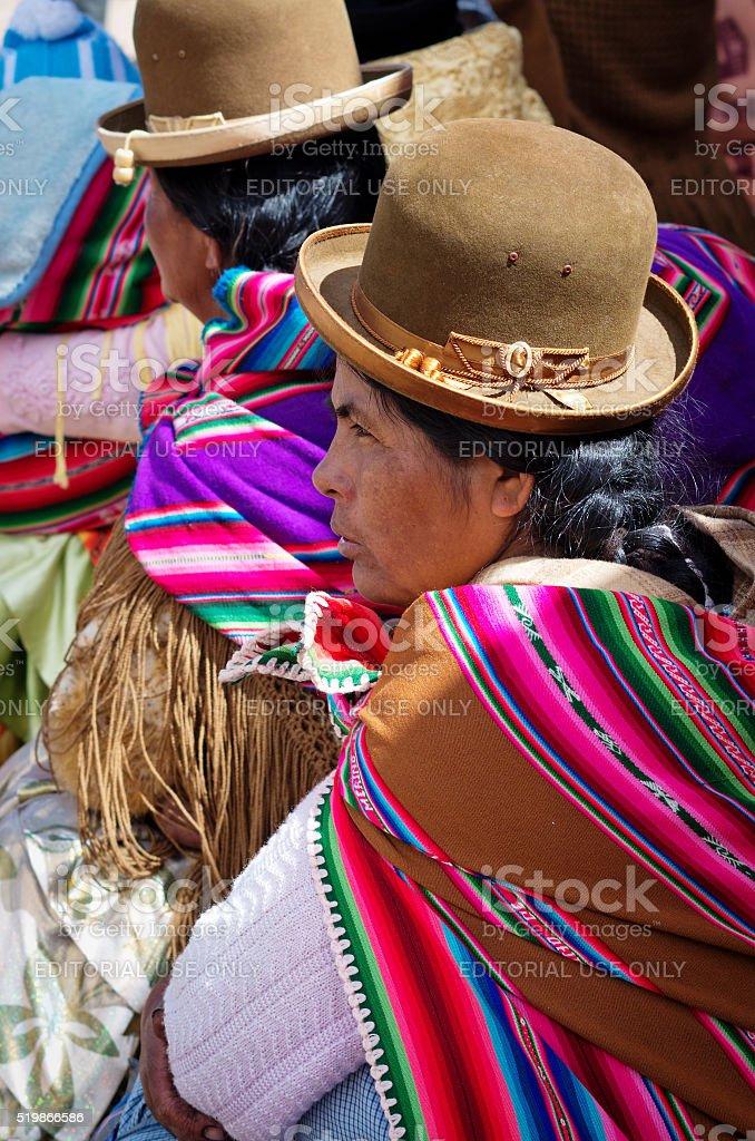 Bolivian women  on the street Copacabana. stock photo