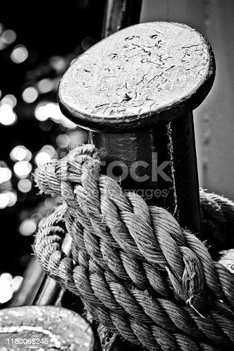 501889762istockphoto Bollard and knotted rope 1180068246