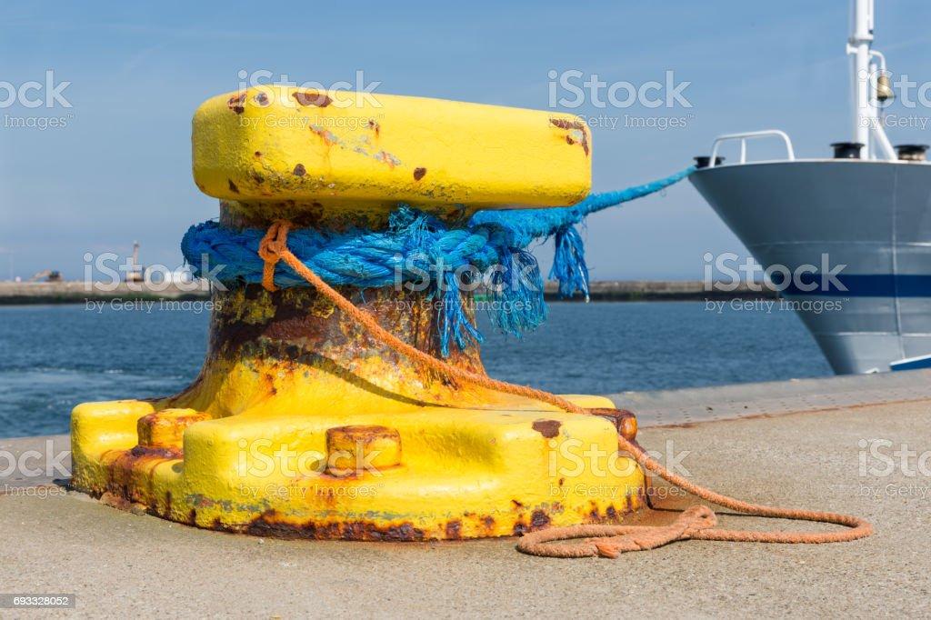 Bollard with moored ship at Helgoland island, Germany stock photo
