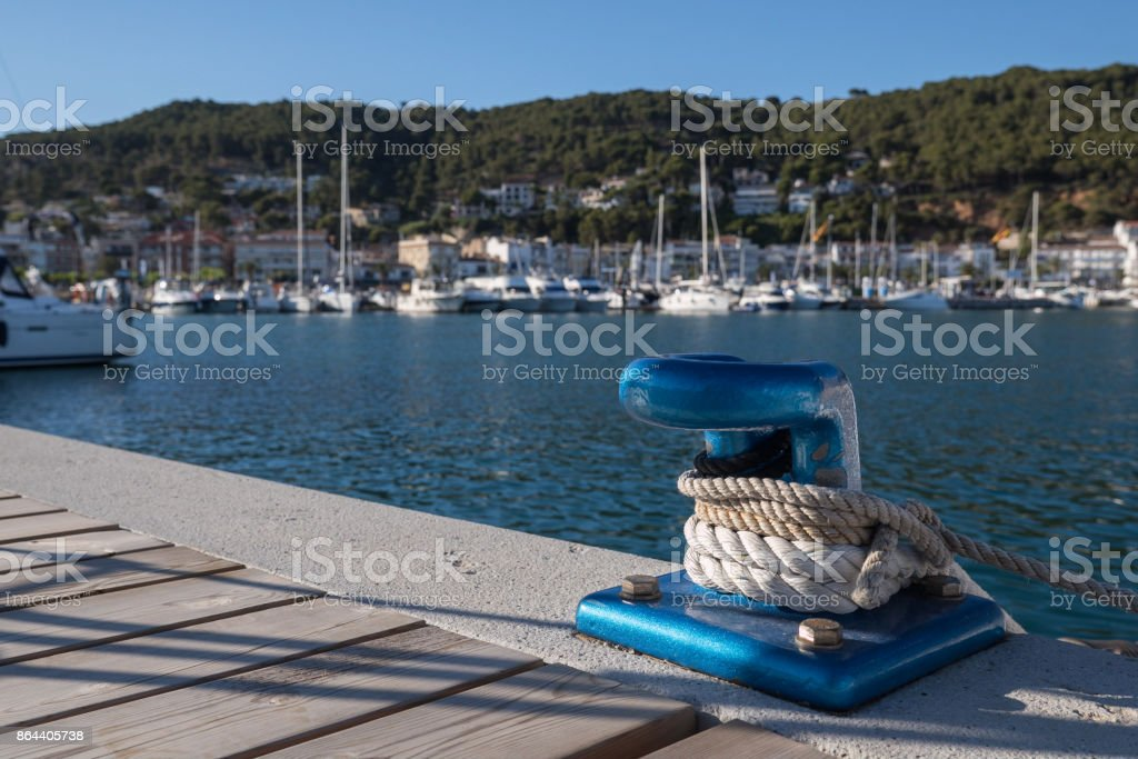 bollard with ropes in the port of Estartit stock photo