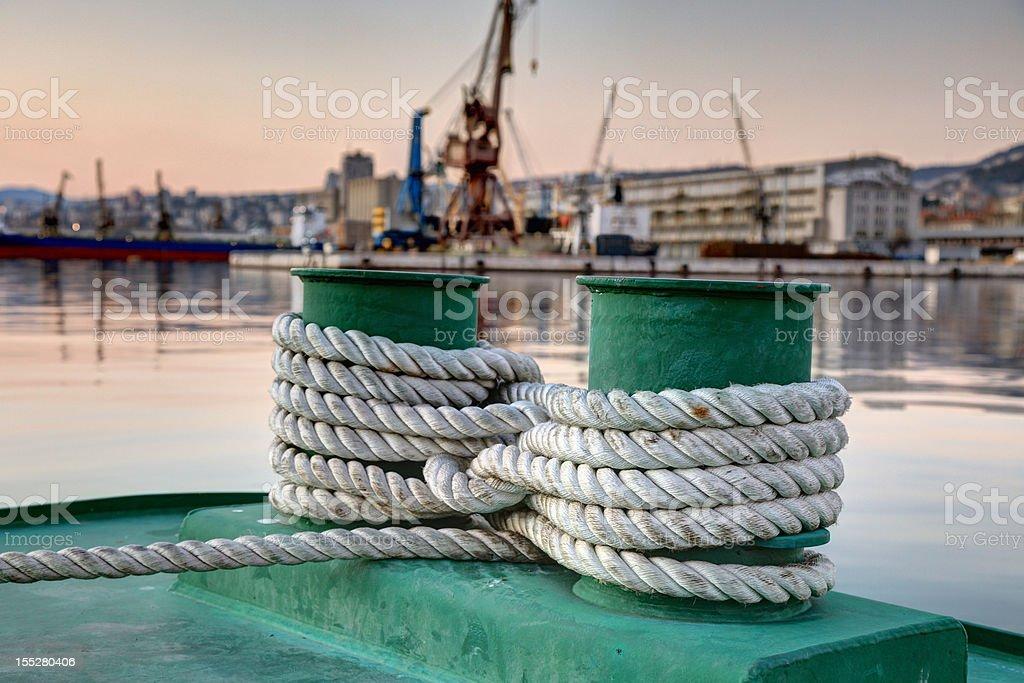 Bollards and white rope stock photo