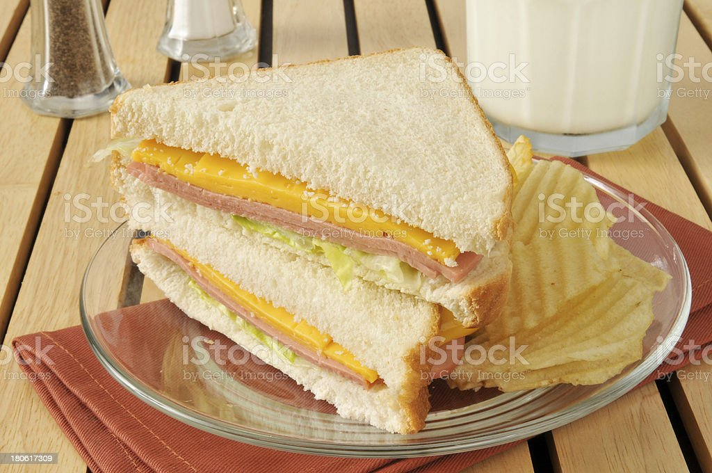 Bologna and cheese sandwich with milk royalty-free stock photo