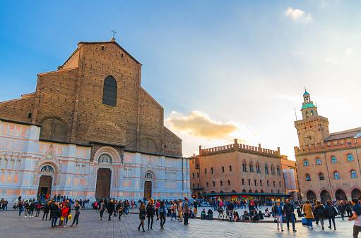 Bologna, Italy, March 17, 2018: Basilica di San Petronio church building facade and Palazzo d'Accursio (Palazzo Comunale) palace on Piazza Maggiore square in old historical city center, Emilia-Romagna