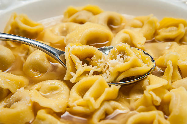 Bologna Tortellini and Parmesan cheese stock photo