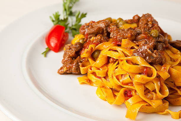 Bolognaise sauce and italian pasta tagliatelle A portion of tagliatelle, italian pasta romagnola, with bolognaise sauce tagliatelle stock pictures, royalty-free photos & images