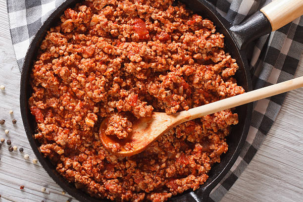 Bolognese sauce in a frying pan close-up horizontal top view stock photo