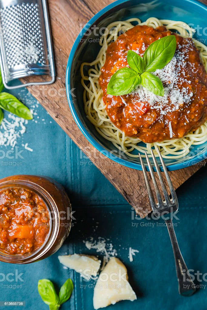 Bolognese spaghetti with cheese and basil stock photo