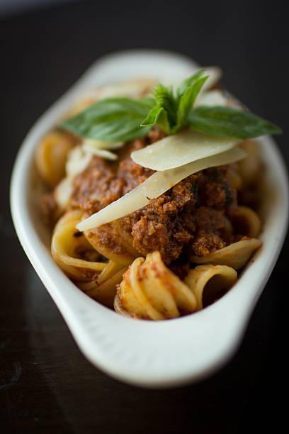 Bolognese Tapas Bolognese sauce over orecchiette pasta orecchiette stock pictures, royalty-free photos & images