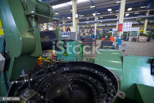 istock Bolt manufacturing factory 614874494