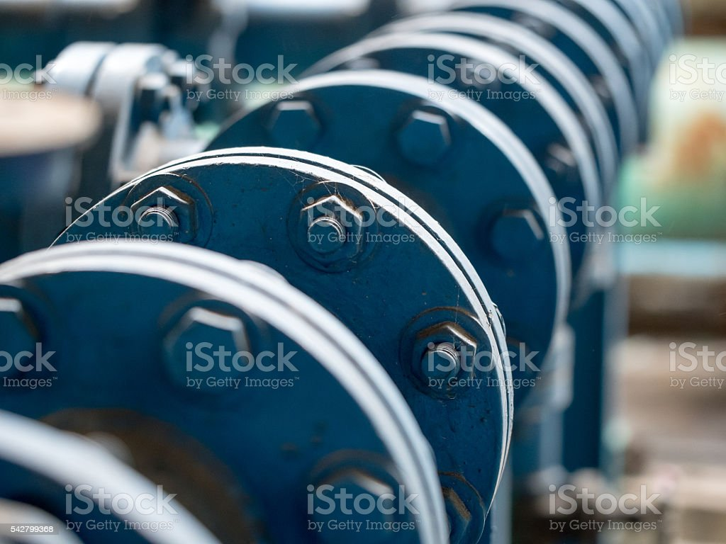 Bolts and nuts connection joint of blue stainless steel pipe stock photo
