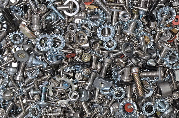 Bolts, nuts, screws and washers Bolts, nuts, screws and washers background washer fastener stock pictures, royalty-free photos & images